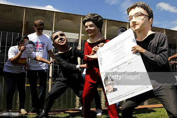 Members of the Avaaz online community organization stage in front of the Itamaraty Forein Ministry Palace the delivery of the Brazilian passport by...
