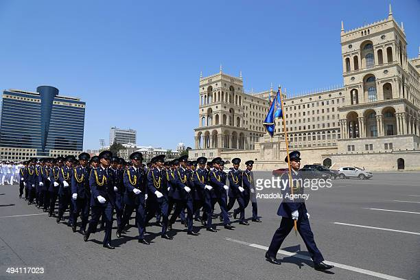 Members of the Azerbaijani security forces march during a military parade marking the 96th anniversary of the establishment of the Azerbaijan...