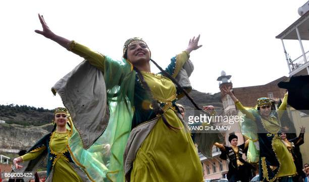 TOPSHOT Members of the Azeri diaspora in Georgia wearing traditional costumes dance as they celebrate Nowruz in Tbilisi on March 21 2017 Nowruz The...