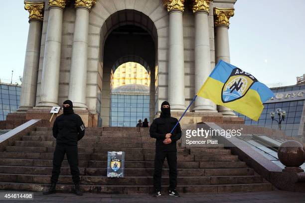 Members of the Azov Battalion, a far-right group of militant activists, stand in Independence Square, or Maidan Square, on September 4, 2014 in Kiev,...