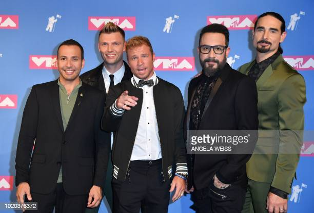 Members of the Backstreet Boys Howie Dorough Nick Carter Brian Littrell AJ McLean and Kevin Richardson pose in the press room during the 2018 MTV...