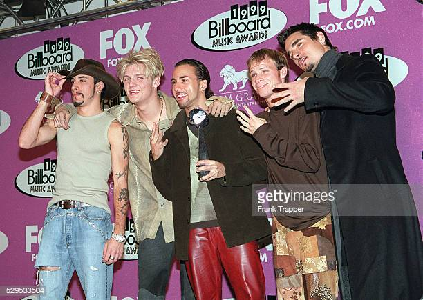 Members of The Backstreet Boys with their award