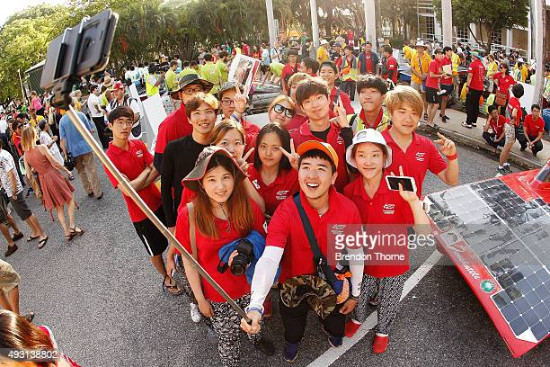 Members of the BaekHo of KUST South Korea Challenger Class pose for a 'selfie' with their car prior to the start of Day 1 of the 2015 Bridgestone...