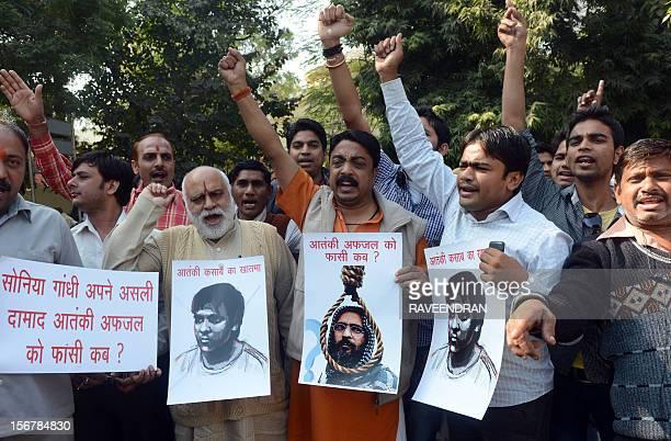Members of the Bajrang Dal hold posters of Mohammed Kasab surviving gunman of the 2008 Mumbai attacks and Mohammad Afzal Guru a JaisheMohammad...