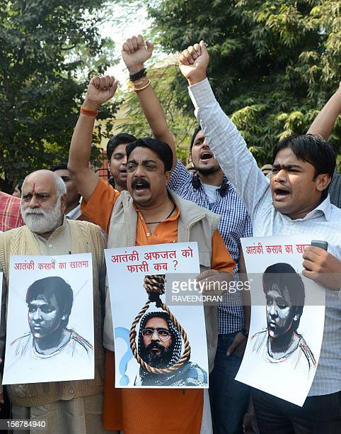 Members of the Bajrang Dal hold posters of Mohammed Kasab surviving gunman of the 2008 Mumbai attacks and Mohammad Afzal Guru a JaisheMohammad...