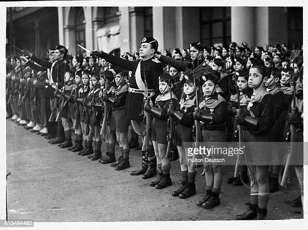 Members of the Balilla Italy's Fascist youth movement greet PremierDictator Benito Mussolini after his return from England