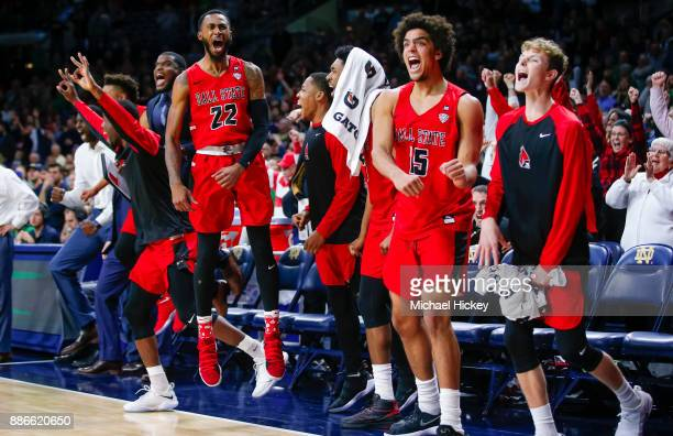 Members of the Ball State Cardinals celebrate in the closing seconds after defeating the Notre Dame Fighting Irish at Purcell Pavilion on December 5...
