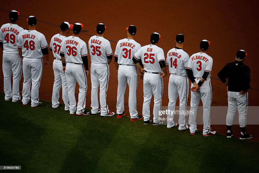 Members of the Baltimore Orioles line up before the start of their Opening Day game against the Minnesota Twins at Oriole Park at Camden Yards on April 4, 2016 in Baltimore, Maryland.