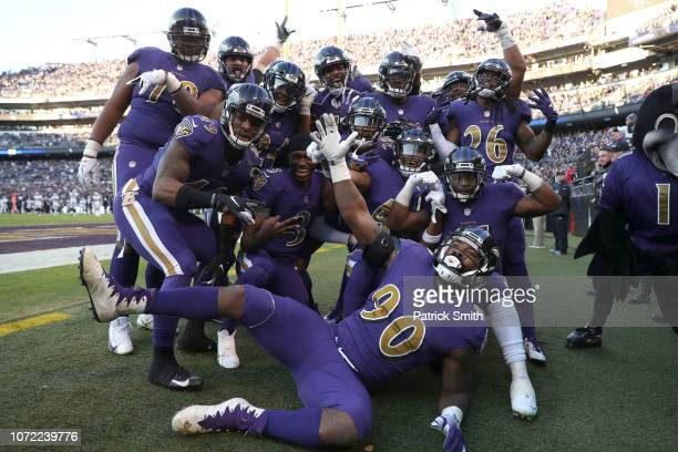 Members of the Baltimore Ravens celebrate after a touchdown in the fourth quarter against the Oakland Raiders at MT Bank Stadium on November 25 2018...