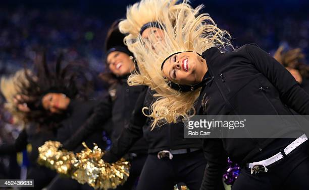 Members of the Baltimore Ravens cheerleaders preform during the first half of the Ravens and Pittsburgh Steelers game at MT Bank Stadium on November...