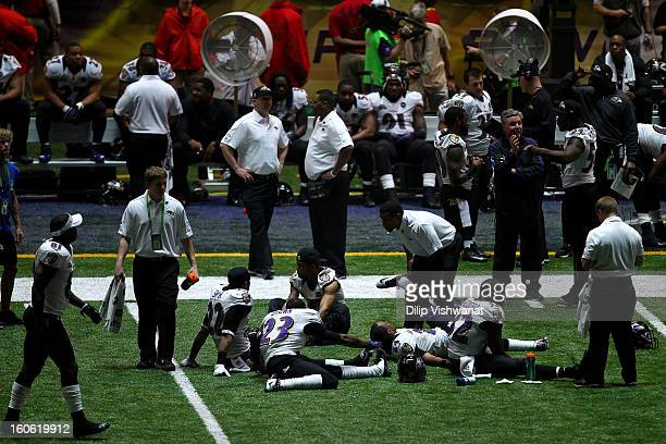 Members of the Baltimore Ravens stretch during a power outage in the third quarter that caused a 34minute delay during Super Bowl XLVII against the...