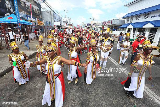 Members of the band 'A Touch of Woodbrook Then and Now' presented by Trini Revellers perform during the Parade of Bands as part of Trinidad and...