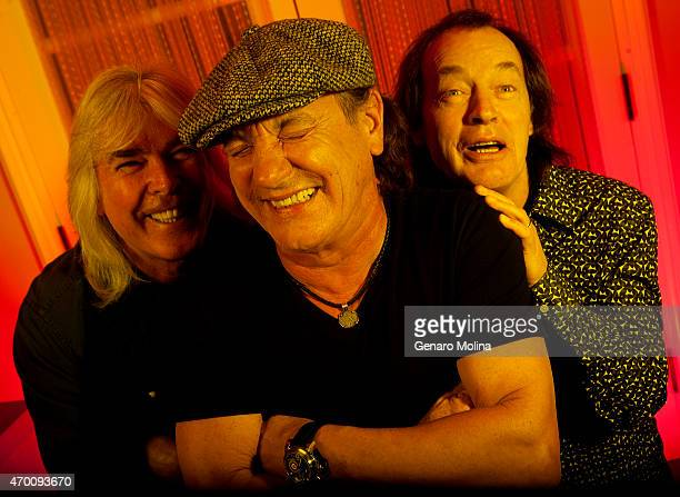 Members of the band AC/DC Brian Johnson Angus Young and Cliff Williams are photographed for Los Angeles Times on April 7 2015 in Beverly Hills...