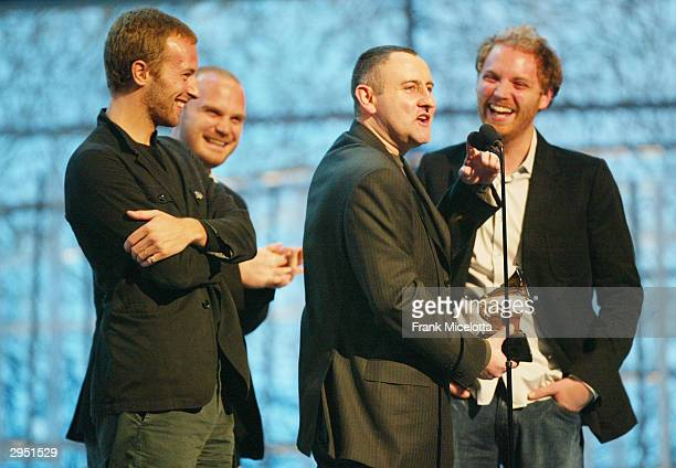 Members of the band Coldplay receive Record Of The Year at the 46th Annual Grammy Awards held at the Staples Center on February 8 2004 in Los Angeles...
