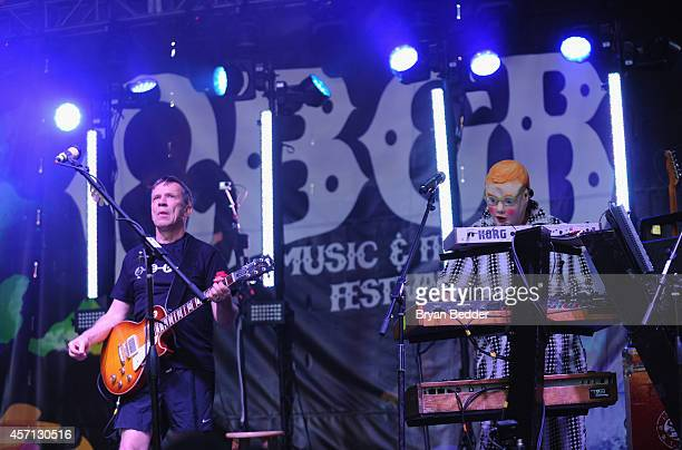 Members of the band Devo Bob Mothersbaugh and Mark Mothersbaugh perform during CBGB Music Film Festival 2014 Times Square Concerts on October 12 2014...