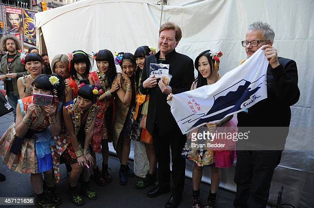 Members of the band Devo Gerald Casale and Mark Mothersbaugh pose backstage with Cheeky Parade during CBGB Music Film Festival 2014 Times Square...