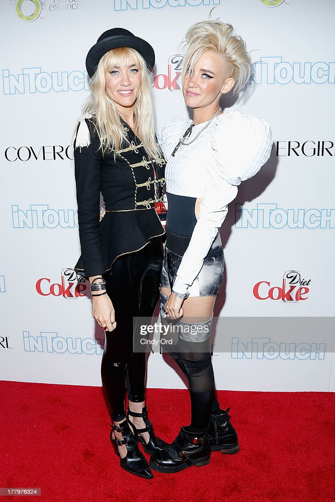 Members of the band Nervo Miriam Nervo and Olivia Nervo arrive at Intouch Weekly's 'ICONS & IDOLS Party' at FINALE Nightclub on August 25, 2013 in New York City.