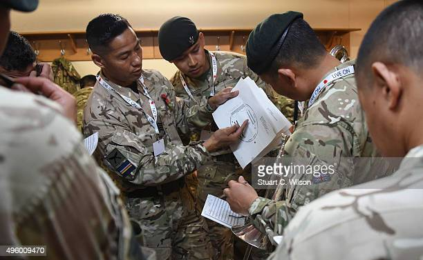 Members of The Band of the Brigade of Gurkhas preparing for their rehearsal for The Royal British Legion's Festival of Remembrance at the Royal...