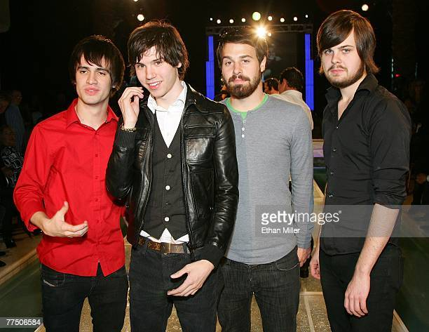 Members of the band Panic at the Disco frontman Brendon Urie guitarist Ryan Ross bassist Jon Walker and drummer Spencer Smith pose at a housewarming...