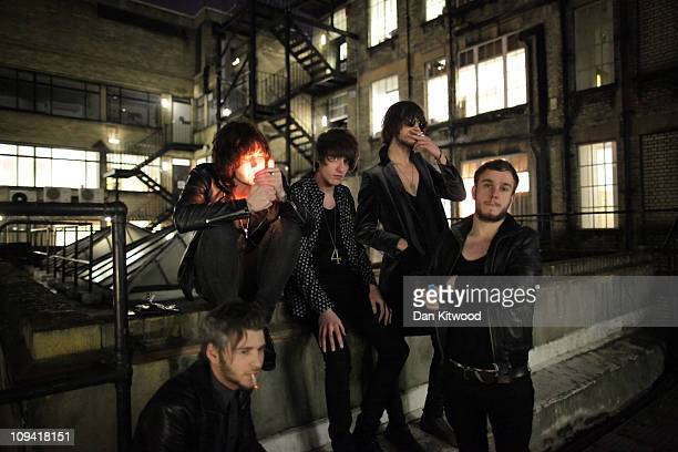 Members of the band Temper the Wolves relax ahead of their performance at the 100 Club on February 24 2011 in London England Since it's opening in...