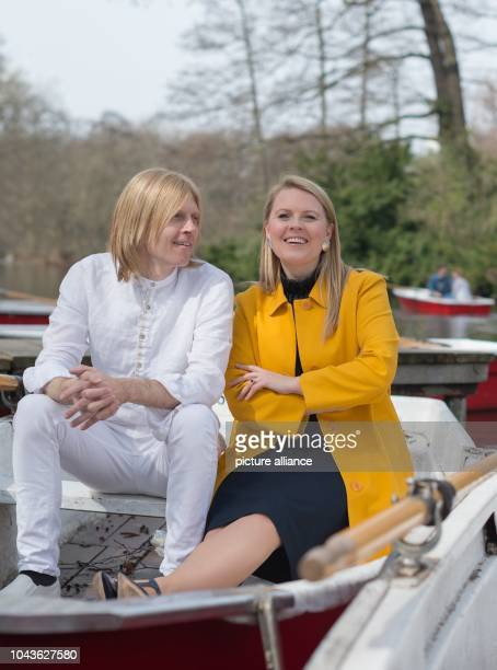Members of the band 'The Kelly Family' Patricia Kelly and John Michael Kelly sit in a boat as they pose at an interview with German news agency...