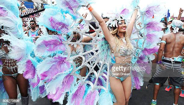 Members of the band 'The Secret Garden' presented by Bliss perform during the Parade of Bands as part of Trinidad and Tobago Carnival at the...