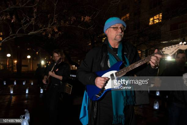 Members of the band Tilted Axes perform during 'Winter Luminaria with Tilted Axes' as part of Make Music Winter on December 21 2018 in New York City