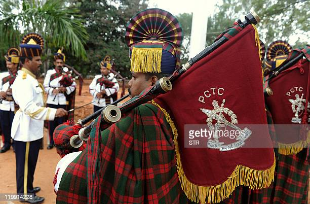 Members of the band troupe of Pioneer Corps Training Centre perform as they take part in 'Flags of Honour' an event held at The National Military...