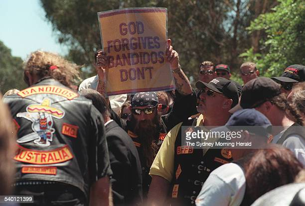 Members of the Bandido motorbike gang attend the funeral of their Mulgoa to bury their national president Michael Kulakowski in Mulgoa one holding a...