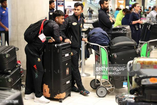Members of the Bangladesh cricket team check into Christchurch Airport as they look the leave on March 16 2019 following the deadly massacre on two...