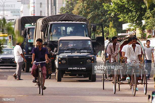 Members of the Bangladeshi Rifles patrol with trucks the streets of Dhaka as a curfew was lifted for three hours in the afternoon 23 August 2007...