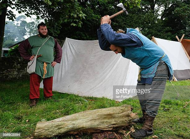 Members of the Barbarian camp chop firewood as the lives of Roman Legionnaires are reenacted during the Hadrian's Wall Live event at Birdoswald Roman...