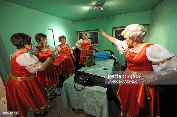 Members of the Barborka pensioniers dancers group prepare to perform a Russian Kalinka on November 30 2011 at a community center in Lazy AFP PHOTO /...