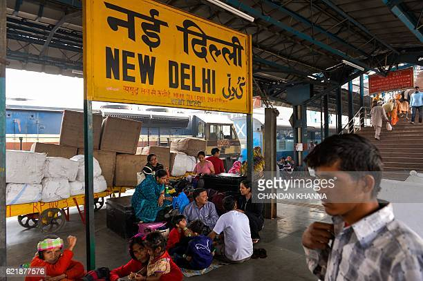 Members of the Bardo family wait for their train at New Delhi railway station in the Indian capital New Delhi on November 9 2016 India's government...