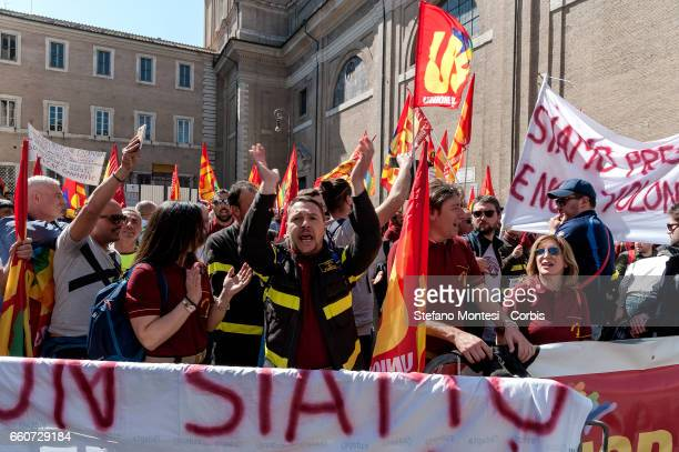 Members of the Basic Trade Union demonstrate in support of firefighters demanding protection of jobs and labour on March 30 2017 in Rome Italy
