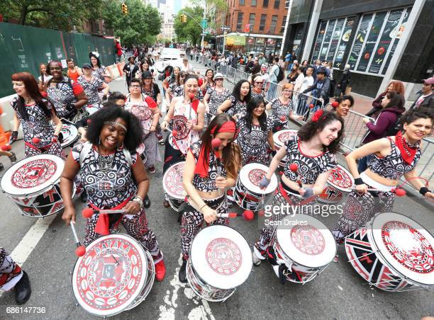 Members of the Batala New York drum troupe perform Samba music during the 11th Annual Dance Parade at Greenwich Village on May 20 2017 in New York...