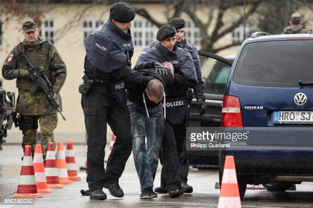 Members of the Bavarian police and the Bundeswehr the German armed forces intercept a vehicle at a checkpoint during a demonstration as part of the...