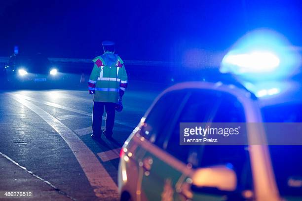 Members of the Bavarian police check cars in the early hours on the A3 highway on September 3 2015 near Passau Germany The A3 and nearby smaller...