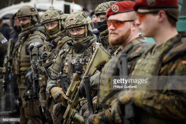 Members of the Bavarian police SWAT team and the Bundeswehr the German armed forces are seen during a demonstration as part of the GETEX antiterror...