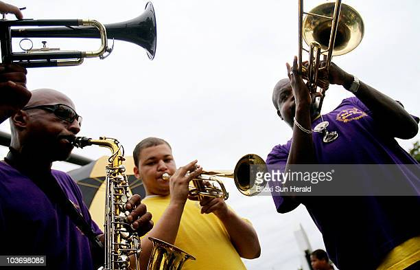 Members of the Bay City Brass Band liven the crowd at the foot of the Biloxi Bay Bridge in Mississippi during a celebration and second line following...