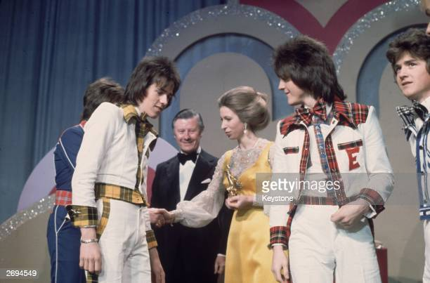 Members of the Bay City Rollers shaking hands with Princess Anne at the Lyceum Ballroom on the occasion of the Carl Alan Awards On the princess's...
