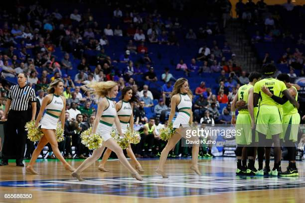 Members of the Baylor Bears cheerleaders perform as players huddle during the 2017 NCAA Photos via Getty Images Men's Basketball Tournament held at...