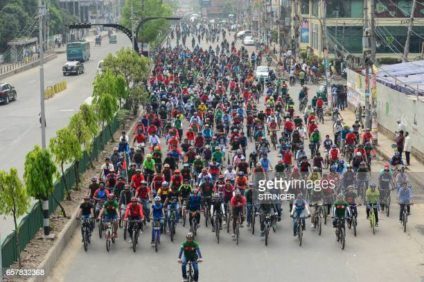 Members of the BDCyclists group participate in a bicycle rally to mark the country's independence day in Dhaka on March 26 2017 Bangladesh became...