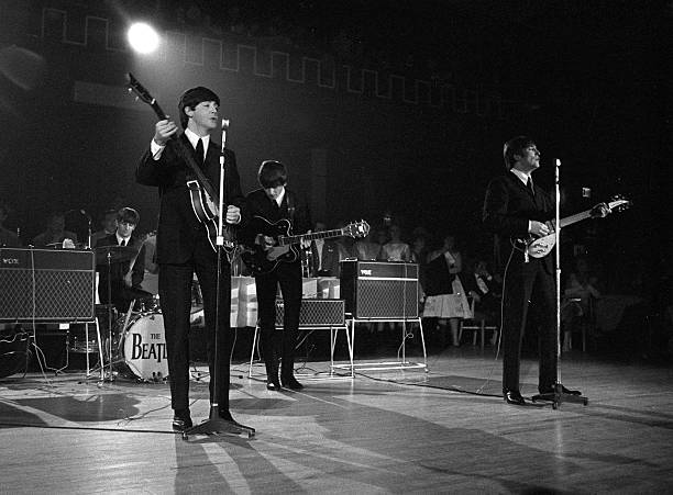 Members Of The Beatles Pop Group Performing On Stage During A