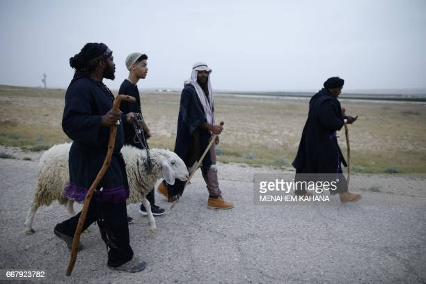 Members of the Beit Yisrael sect part of the African Hebrew Israelite Nation of Jerusalem march before they slaughter a lamb during a Passover...