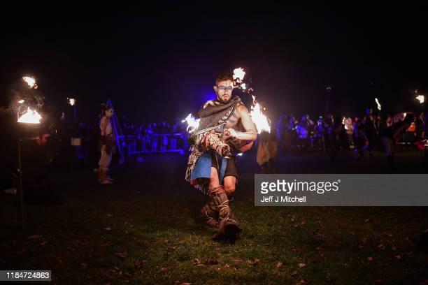 Members of the Beltain Fire Society take part in Samhuinn on Calton Hill on October 31 2019 in Edinburgh Scotland Samhuinn is one of two festivals...