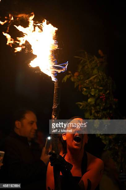 Members of the Beltaine Fire Society take part in Samhuinn which tells the Celtic story of the overthrowing of Summer by Winter with a standoff...