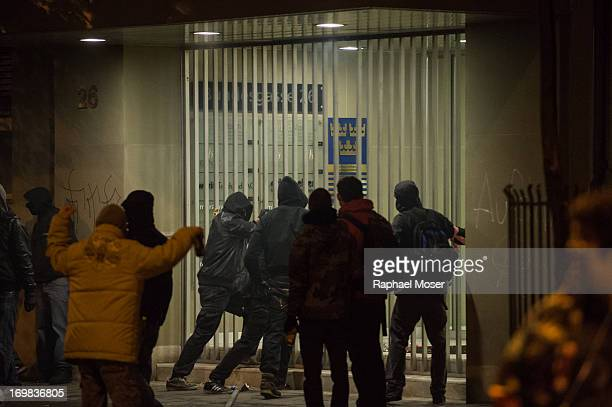 Members of the black bloc try to damage and enter the embassy of Sweden in the center of Switzerland's capital Bern during the 3rd edition of 'Tanz...