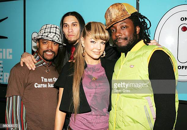 Members of the Black Eye Peas ApldeAp Taboo Fergie and WillIAm pose for a photo backstage during MTV's Total Request Live at the MTV Times Square...