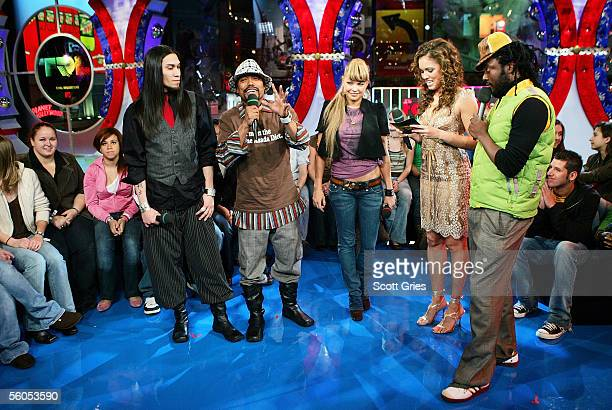 Members of the Black Eye Peas Taboo ApldeAp Fergie and WillIAm appear onstage with VJ Susie Castillo during MTV's Total Request Live at the MTV Times...